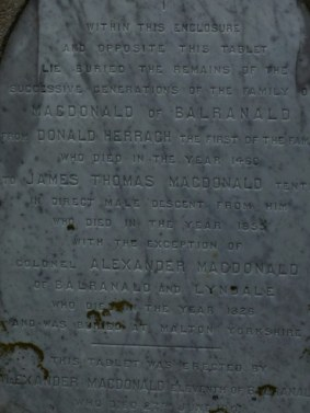 Memorial inscription, first person buried here in 1400s.