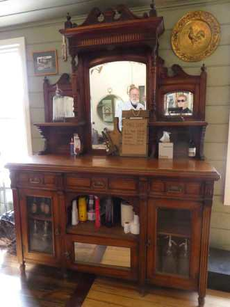 Old Barbershop cabinet, you can get your hair cut there now.